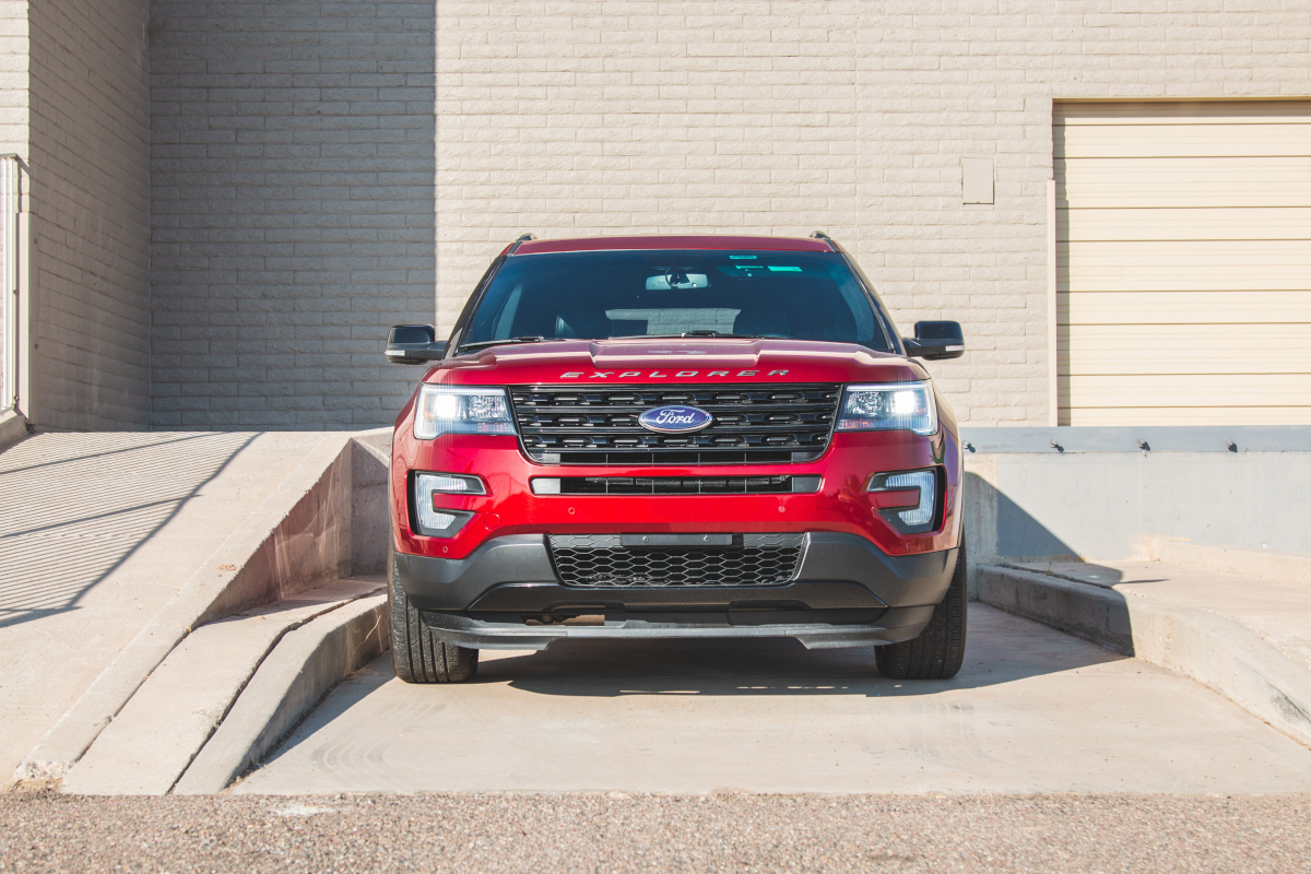Front view of a stock form Red Ford Explorer