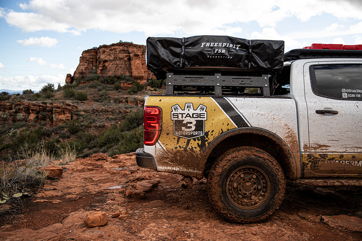 Side view of Stage 3 Motorsports' 2019 Ford Ranger equipped with a bed rack and tent in Sedona, Arizona!